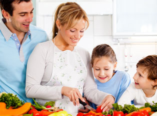 a family cooks a healthy meal to prevent the onset of diabetes