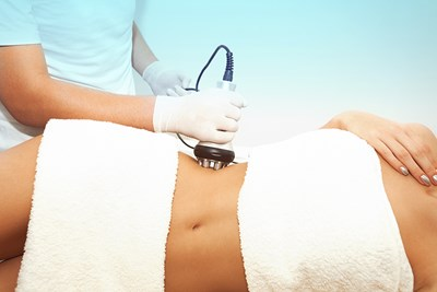 A woman undergoes cellulite treatment