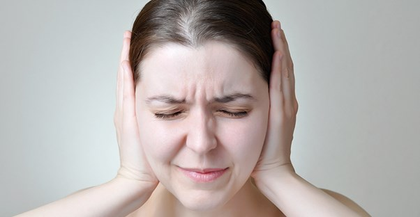 A woman struggles with hearing loss