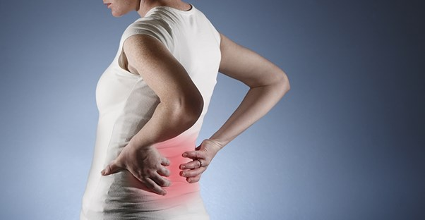 A woman experiences back pain