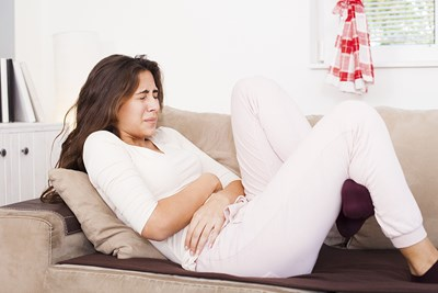 A woman experiences period pain