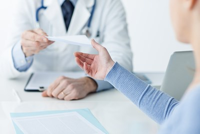 A doctor and patient discuss TSS