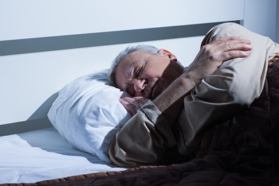 An elder experiences nocturia