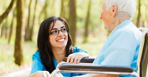 a nurse assists an aging alzheimers patient