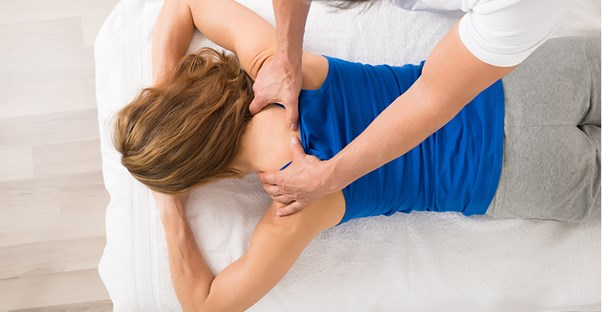 Woman getting massage for neck pain
