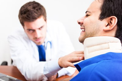 Doctor treating neck pain