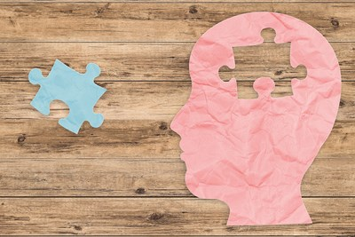head and brain puzzle piece coma