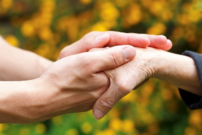 two people holding hands to represent arthritis