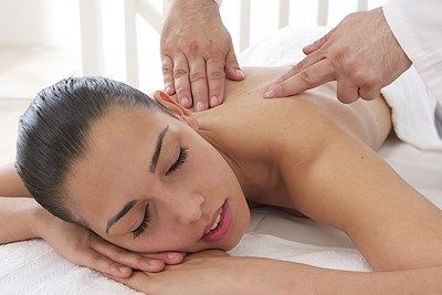 woman getting a massage because she has a trigger point