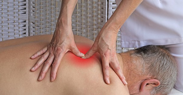 man receiving trigger point therapy