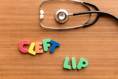 Cleft lip spelled out in alphabet toys with a stethoscope.