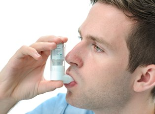 a man tries out his clear inhaler to combat his asthma