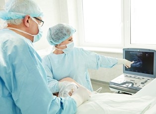 doctors performing a varicose vein surgery