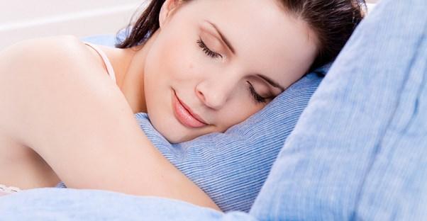 a woman who is preventing sleep apnea