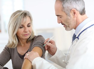 a woman getting a shingles vaccine