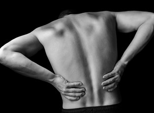 a woman suffering from ankylosing spondylitis symptoms