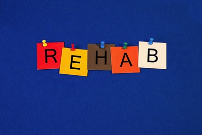 Post-its with letters form the word REHAB.