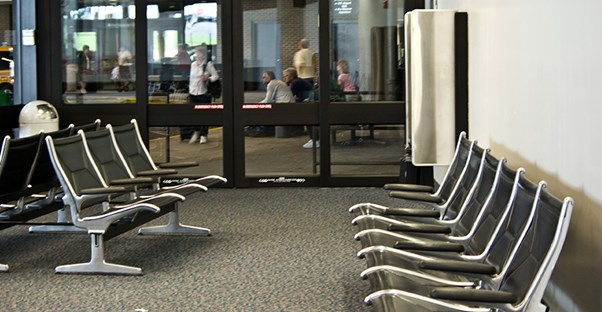 An empty waiting room looks out to the hospital curb where patients are waiting to be picked up.