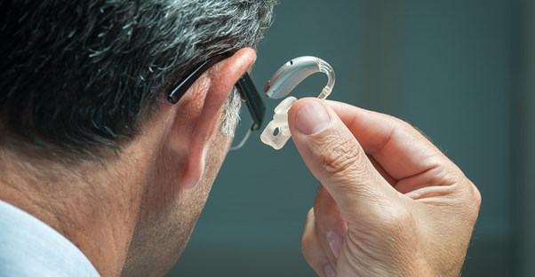 a man wearing a hearing aid