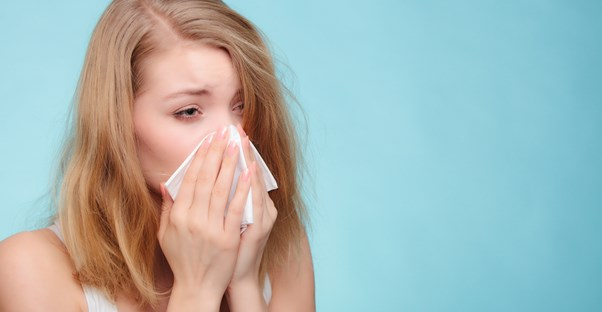 a woman suffering from sinusitis symptoms