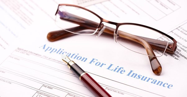 life insurance papers viewed by a person with HIV