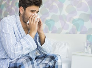 a man suffering from the common cold