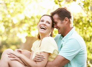 a couple laughing about erectile dysfunction remedies