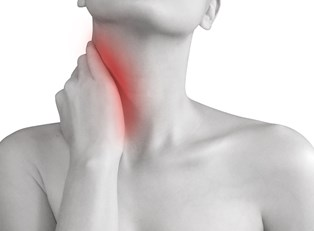 a woman experiencing neck pain