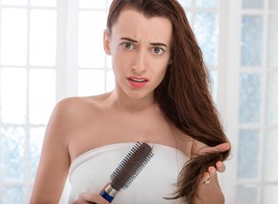 A woman treats her hair loss