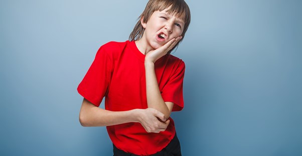 a boy wondering whether canker sores are contagious