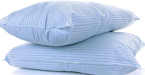 Two blue striped pillows are stacked on top of each other.