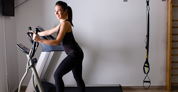 A woman exercises at home