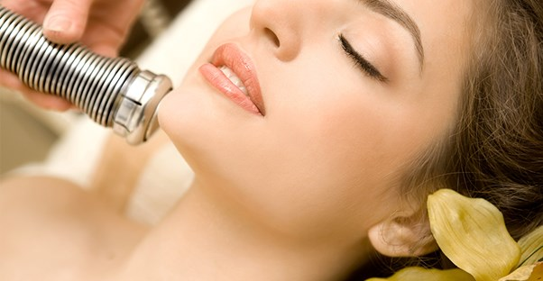 A woman undergoing electrolysis
