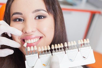 A woman tries cosmetic dental implants
