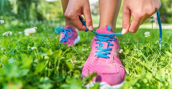 A woman prepares for a run