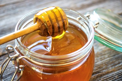 jar of honey as a home remedy for cough suppression