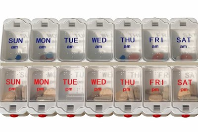 common medications in a pill dispenser