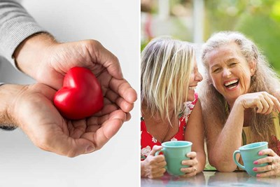 women laughing man holding heart shaped tomato