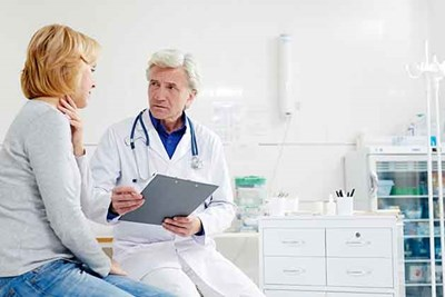 A woman talks with her doctor about what health screenings she should be getting.