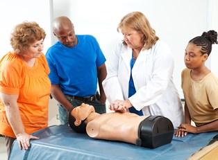 people learning the difference between hands-on and conventional CPR