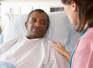 a doctor explaining men's catheters
