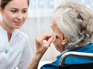 a woman who is curious about hearing aids and medicare