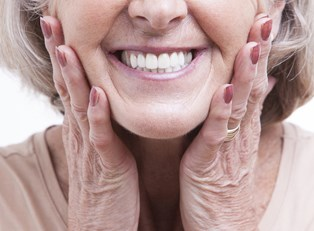 a woman who knows how much dentures cost