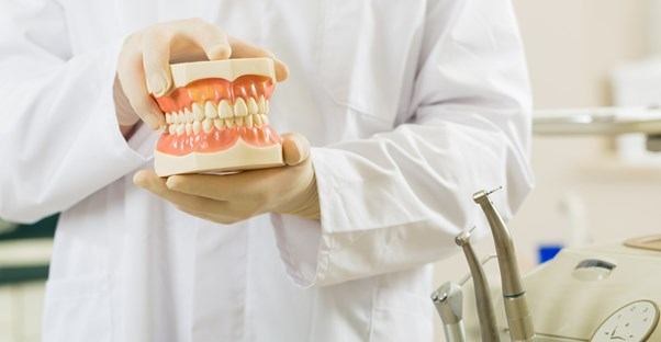 a dentist who understands the differences between full and partial dentures