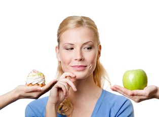 a woman choosing between two snacks