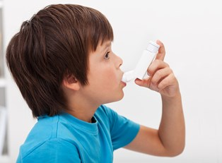 a boy using an inhaler