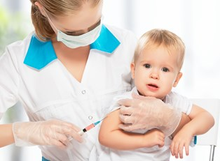 a baby getting a vaccine