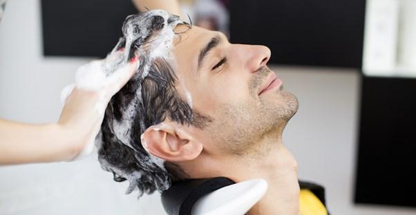 A hair restoring shampoo cures a mans baldness