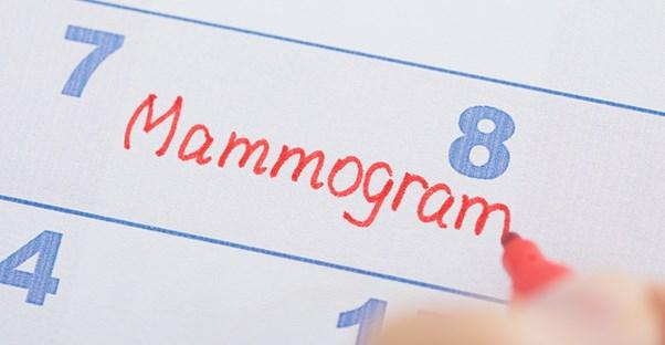 A woman schedules a mammogram